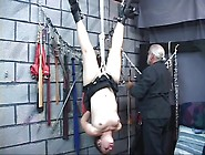 Rope Bound Cutie Hangs Upside Down In His Dungeon