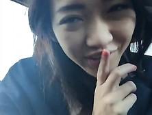 Oriental Teenager Woman Masturbating In The Auto