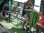 Dangling Pumps While Smoking At Table