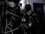 Male Slave Is Chained And Lets His Mistress Play With His Cock