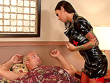 Busty Babe Dressed In Latex Wakes Up A Guy For A Great Shag