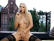 Sensuous Blonde In Black Stockings Fucks Her Wet Pussy On The Ba