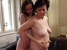 Mature Woman Likes To Put On A Strap- On And Fuck Her Young Lesb
