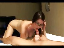 Busty Brunette Nerd In Glasses Is Giving Him A Nice Blowjob