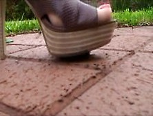 Heels Crush Snail In Park
