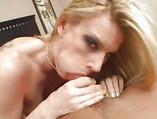 Darryl Hanah Stuffs Her Mouth With Hard Cock