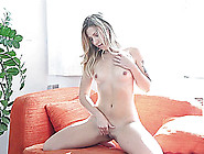 Small Tits Solo Model Posing On Sofa Displaying Her Juicy Pussy