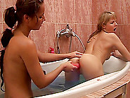 Slender Bodied Lesbian Teens Share Hot Tub And A Pink Dildo
