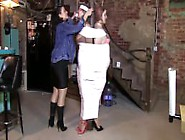 Woman Duct Taped With White Tape To Two Women In The Column Of A
