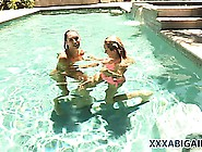 Two Babes Are Out In The Pool And Playing Grab Ass And Stripping