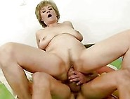 Grandma And Teen Sharing A Dildo
