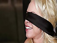 Blindfolded Blonde,  In A Red Dress Is Sucking Two Hard Dicks,  At