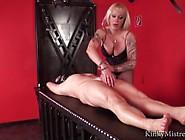 Strong German Femdom Mistress Slaps Saline Filled Balls Of Slave