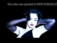 The Starlet Dita Von Teese Doing A Striptease And Smoking