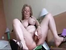 Busty Mature Woman Masturbates