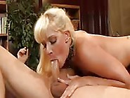 Blonde Milf Riding Dick On The Table