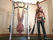 Slave Is Hanged Upside Down In The Gym