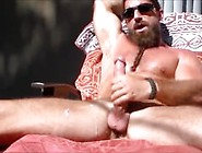 Muscle Daddy Jerks Off In The Sun