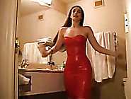 Damn Horny Long Haired Brunette Lady Posed In Her Red Latex Dres