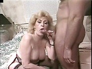 Kitty Foxx Impresses A Younger Stud With Her Amazing Cock Suckin