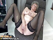 Sexy Granny In Black Stockings Loves Pleasing Her Own Pussy With