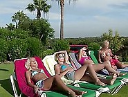 Four Hot Girls Sunbathe In The Yard And Play Lesbian Games