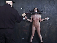 Curly Haired Lady Restrained With Pillory And Groped