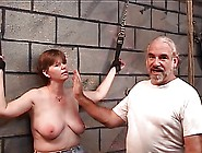 Slave Gets Leather Cuffs On Her Wrists And Master Puts A Whip On