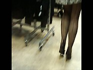 Shopping For New Shoes In Black Seamed Stockings And A Mini Dres