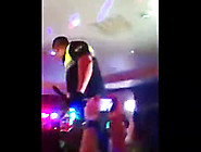 Venezuelan Girl Goes Behind The Flag Onstage With Male Stripper