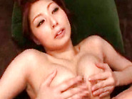Busty Japanese Babe Stroking A Big Cock Between Her Tits