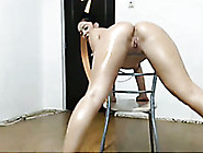 Flexible Babe Oils Up Her Sexy Body And Poses Seductively