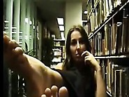 Girl Teasing Her Feet At The Library