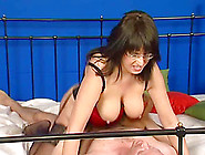 A Chubby Milf In A Lingerie And Glasses Gets Nailed In A Bedroom