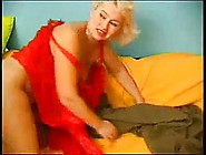 Mature Blonde Woman Was Wearing Red Dress While She Was Having S