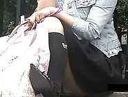 Asian Girls In Mini Skirt Are Being Spied On While Sitting Along