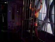 Caged Bondage Babe Toyed By Horny Brunette Lesbian