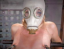 Blonde With A Gas Mask Over Her Face Spreads Her Legs For A Mist