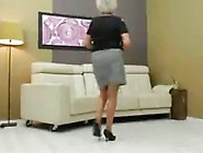 Horny Blond Granny Is Masturbating On Her Couch While Inserting