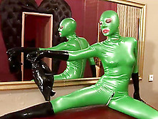 Babe In Latex Lily Is Posing In Her Green Mask