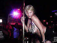 Amateurs Dance On The Pole At A Club Party