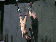 Grey Haired Master Ties Up Hands Of Hanging Upside Down Brunette