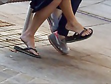 Sexy Legged Tanned Girl In Flip Flops With Dangles