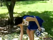 Nasty Cheerleader Caresses Wet Pussy Outdoors