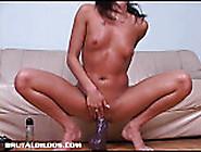 Brunette Fucking A Massive Dildo