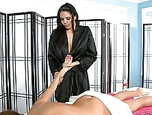 Dark Haired Masseuse Is Wearing Satin Robe While Working With Cl