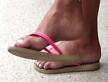 Passionate Girl With Cute Feet Wearing Flip Flops In Public And