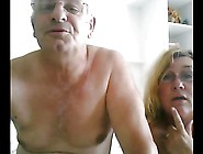 Older Couple Play In Bed