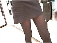 Shop Assistant In Opaque Black Tights And Mini Skirt
