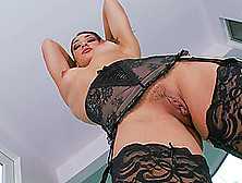 She Is Posing Seductively Before Fingering Her Pussy Erotically